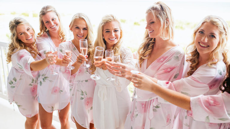 Bridal party giving a toast at Avalon Yacht Club
